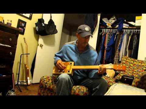 "The Original ""Leslie"" Punch 4 String Cigar Box Guitar"