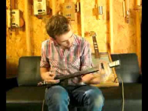 Black Rocker Cigar Box Guitar by Ted Crocker
