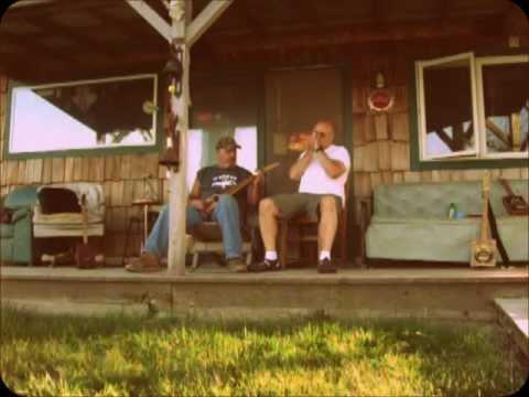 OLD repost of Maddog (and John) at Maddog's riverside CBG shack.