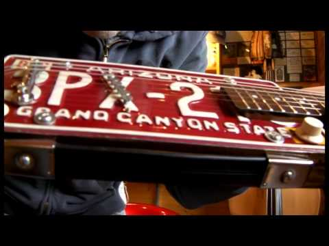 LICENCE PLATE RESONATOR CIGAR BOX GUITAR BY JUNKSVILLE GUITARS