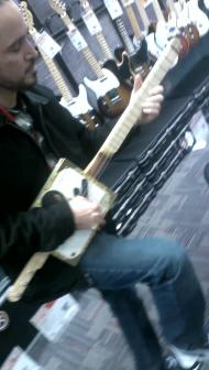 AJ at little rock guitar center on the headless macanudo