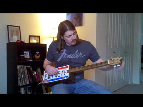 4-string License Plate Guitar (wrecked)