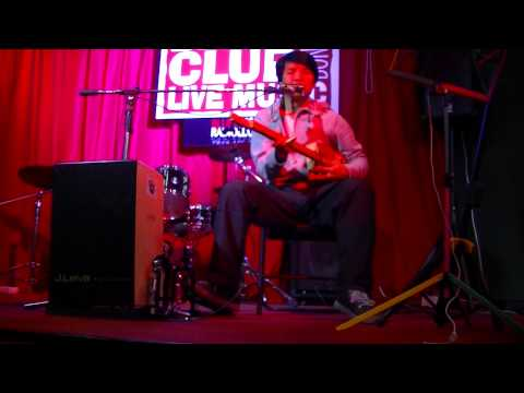 Bonny B. sings and plays with his Cigar Box Guitar with one string