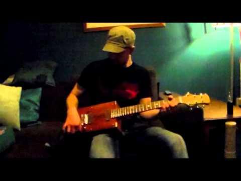 Quick sound check on 6 string wine box guitar