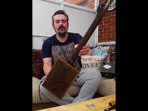 Moonshine 4 string resonator cigar box guitar by Hubcap john