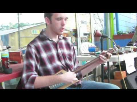 Dylan Franklin performing using a Ted Crocker Po' Boy Canjo