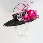 Fabric covered crown on sinamay boater with hand made feather flowers.