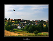 A Kite watching over a Village