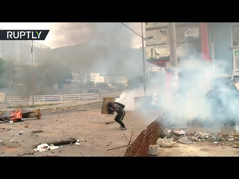 """Protesters clash with police, set govt building on fire in Quito, Ecuador"""