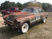 Old busted down Caddy