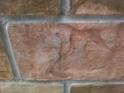 Concrete block wall concrete overlay