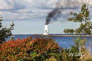Ludington Michigan lighthouse using the original light source. Photograph is Photoshopped
