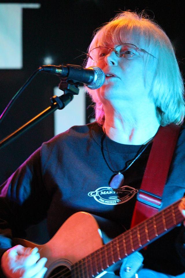 Denise MIller on guitar 2016