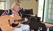 Denise plays guitar
