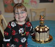Alyssa with LOL Queen Bee Birthday Cake