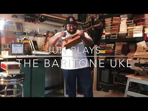 Jun plays the baritone cigar box uke
