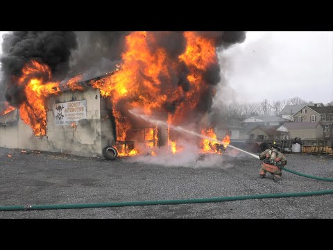 PRE-ARRIVAL:  2nd alarm auto repair shop fire
