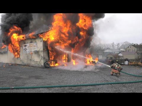PRE-ARRIVAL:  2nd alarm auto repair shop fire