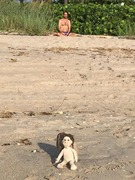 yoga doll and man on beach