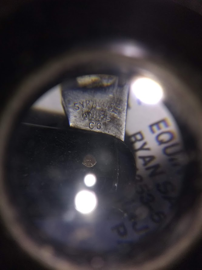 Tang stamp magnification