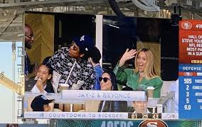 JAY Z AND FAMILY SIT DURING NATIONAL ANTHEM AT SUPERBOWL