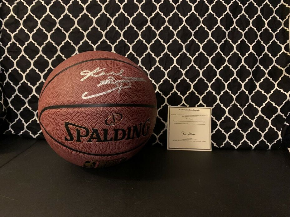 Likely not Genuine: BOLD SILVER Kobe Bryant Autographed NBA Indoor/Outdoor Basketball $400
