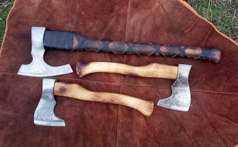 Hand-forged axes etched with Slavic signs