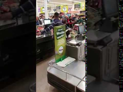 Moment fight breaks out in the aisle of a Woolworths in Bass Hill