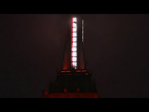 Empire State Building lights up to honor coronavirus fighters