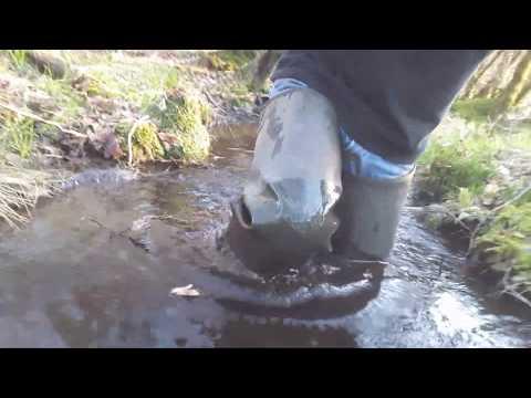 Walk in waders in deep water and mud
