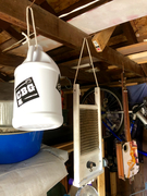 Jug, washboard, and CBG hanging in the workshop