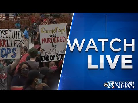 Protesters march in downtown Houston for George Floyd