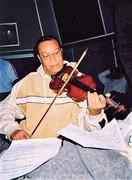 Minister Louis Farrakhan playing his violin   ~