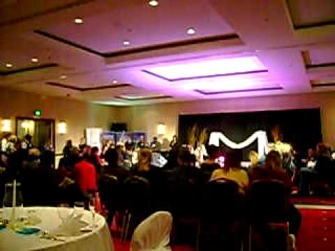 Tanya Waltrick President of T Rose Bridal Show introduces the speakers at Dec. 12, 2010 show