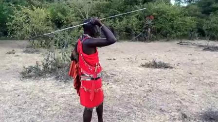 Maasai (Lenny Koshal) spear throwing and bow shooting.