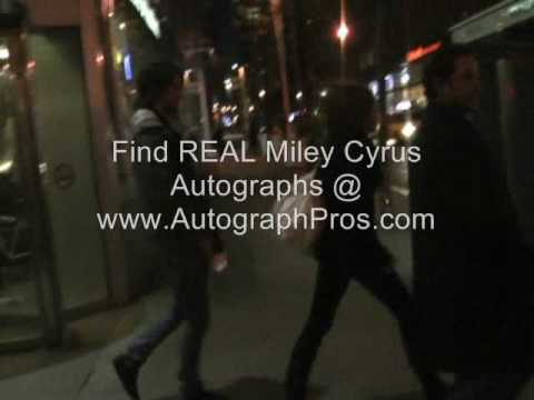 Hannah Montana Miley Cyrus stops to sign some autographs.