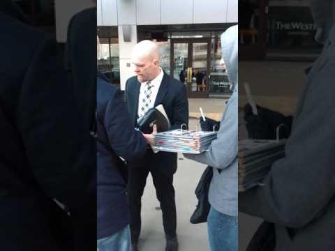 Chris Mason of the Nashville Predators signs autographs for fans in Edmonton