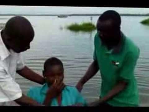 Pastor Davis Baptizing new believers.