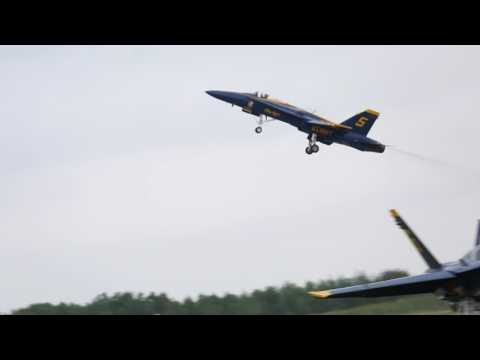 Blue Angels perform Barrell Roll stunt very close to ground in Duluth Air Show in Minnesota