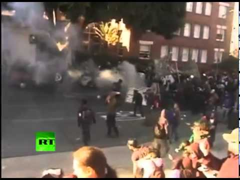 Police use flashbang grenades and tear-gas against Occupy Oakland