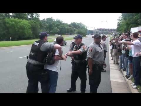 Man Unjustly Arrested at Bilderberg for Walking 2 Steps in Street