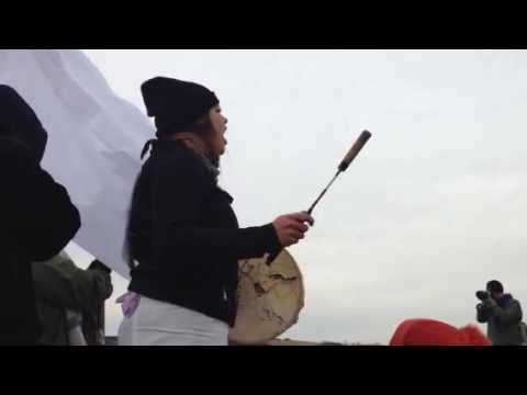 Singing and praying at barricade Standing Rock