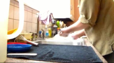 man cleaning kitchen