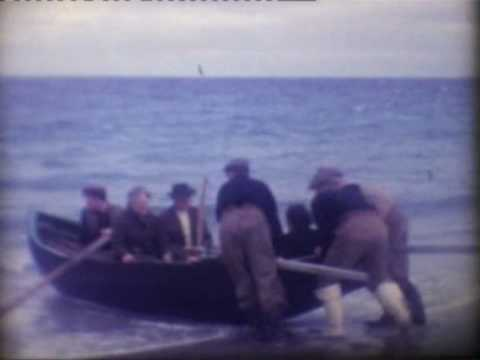 Aran Island Ireland, 1960s Inismaan islanders & currach boats at sea