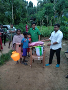 poor lady with grand kids- Gudalur