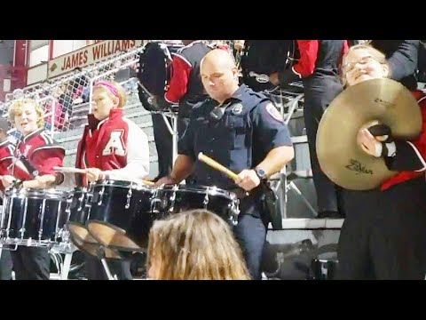 Arkansas Cop Drums With High School Football Band