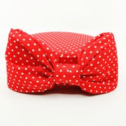 Red and white polka dot pillbox with matching bow