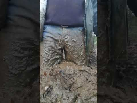 Boots and jeans in manure