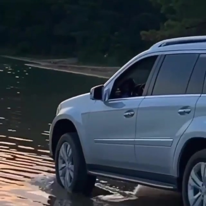 Man drives his Benz into the water & gets stuck