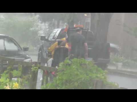 Good Samaritan caught pushing disabled man's wheelchair uphill in thunderstorm